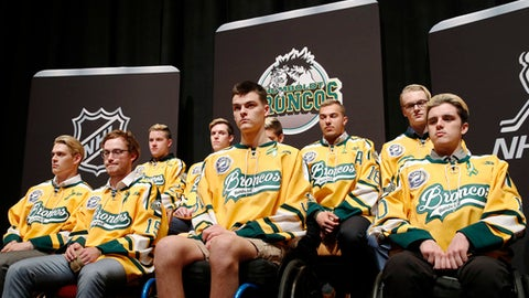 Members of the Humboldt Broncos hockey team attend a news conference Tuesday, June 19, 2018, in Las Vegas. The Saskatchewan junior hockey team's bus was in a collision with a semi-trailer on a rural highway in April resulting in multiple fatalities and injuries. (AP Photo/John Locher)