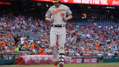 Baltimore Orioles' Trey Mancini crosses the plate after hitting a two-run home run during the fourth inning of the team's baseball game against the Washington Nationals at Nationals Park, Tuesday, June 19, 2018, in Washington. (AP Photo/Carolyn Kaster)