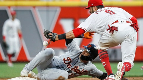 Detroit Tigers' Jose Iglesias, left, steals second against Cincinnati Reds second baseman Jose Peraza (9) during the fifth inning of a baseball game Tuesday, June 19, 2018, in Cincinnati. (AP Photo/John Minchillo)