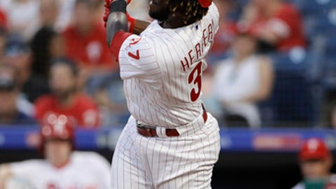 Philadelphia Phillies' Odubel Herrera follows through after hitting a home run off St. Louis Cardinals starting pitcher Luke Weaver during the third inning of a baseball game, Tuesday, June 19, 2018, in Philadelphia. (AP Photo/Matt Slocum)