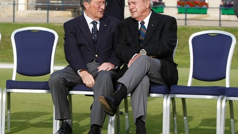 Former British Open Champions Australia's Peter Thompson, left, and Arnold Palmer of the U.S. talk before the group photo of the former champions on the 1st tee on the Old Course at St. Andrews, Scotland, Tuesday, July 13, 2010. 28 Champions have accepted the invitation to play four holes of the Old Course on Wednesday 14 July, the day before the Open Championship gets underway. (AP Photo/Alastair Grant)