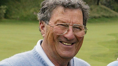 FILE - In this Nov. 24, 2004, file photo Australian golfer Peter Thomson poses for a photo after an exhibition match at the Australian Golf Club in Sydney. Golf Australia says on Wednesday, June 20, 2018, the family of five-time British Open champion Peter Thomson has announced his death. He was 88. (AP Photo/Mark Baker, File)