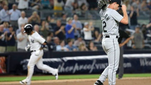 Seattle Mariners relief pitcher Nick Rumbelow, right, reacts as New York Yankees' Gleyber Torres rounds the bases after hitting a home run during the eighth inning of a baseball game at Yankee Stadium Tuesday, June 19, 2018, in New York. (AP Photo/Seth Wenig)