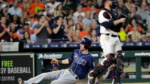 Tampa Bay Rays' Matt Duffy, left, scores as Houston Astros catcher Max Stassi looks to the outfield during the eighth inning of a baseball game Tuesday, June 19, 2018, in Houston. (AP Photo/David J. Phillip)