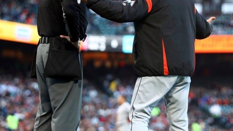 Miami Marlins manager Don Mattingly, right, argues with home plate umpire Andy Fletcher during the second inning of the team's baseball game against the San Francisco Giants on Tuesday, June 19, 2018, in San Francisco. (AP Photo/Ben Margot)