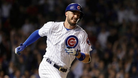 Chicago Cubs' Kris Bryant watches his lead-off triple off Los Angeles Dodgers relief pitcher Brock Stewart during the 10th inning of a baseball game against the Los Angeles Dodgers Tuesday, June 19, 2018, in Chicago. (AP Photo/Charles Rex Arbogast)