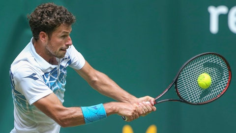 Robin Haase from the Netherlands returns a ball to Bautista Agut from Spain during their match at the ATP tennis tournament in Halle, western Germany, Wednesday, June 20, 2018. (Friso Gentsch/dpa via AP)