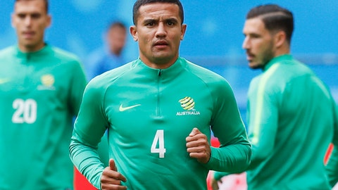 FILE - In this June 15, 2018 file photo, Australia forward Tim Cahill, center, runs during Australia's official training for the group C match between France and Australia at the 2018 soccer World Cup in the Kazan Arena in Kazan, Russia. (AP Photo/Pavel Golovkin, File)