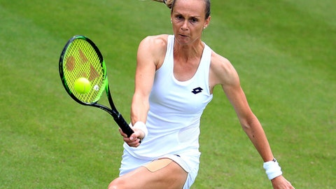 Slovakia's Magdalena Rybarikova returns the ball to France's Kristina Mladenovic on day three at Edgbaston Priory, Birmingham, England, Wednesday June 20, 2018. (Mike Egerton/PA via AP)