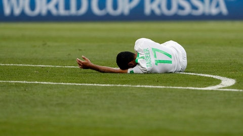 Saudi Arabia's Taiseer Aljassam lies on the pitch during for the group A match between Uruguay and Saudi Arabia at the 2018 soccer World Cup in Rostov Arena in Rostov-on-Don, Russia, Wednesday, June 20, 2018. (AP Photo/Darko Vojinovic)
