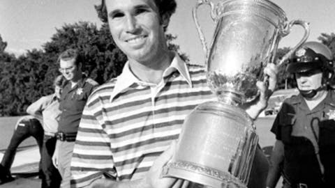 FILE - In this June 19, 1977, file photo, Hubert Green holds the U.S. Open Championship trophy he won at the Southern Hills Country Club in Tulsa, Okla. Hall of Fame golfer Hubert Green, who won a U.S. Open playing portions of the final round despite a threat against his life, has died. He was 71. He was battling throat cancer when he passed away Tuesday, June 19, 2018.  (AP Photo/File)