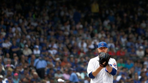 Chicago Cubs starting pitcher Jon Lester checks the runner at first during the fourth inning of a baseball game against the Los Angeles Dodgers Wednesday, June 20, 2018, in Chicago. (AP Photo/Charles Rex Arbogast)