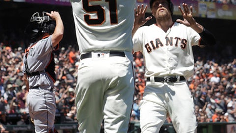 San Francisco Giants' Mac Williamson (51) celebrates with Hunter Pence, right, after both scored against the Miami Marlins during the sixth inning of a baseball game in San Francisco, Wednesday, June 20, 2018. Also pictured at left is Marlins catcher J.T. Realmuto. (AP Photo/Jeff Chiu)