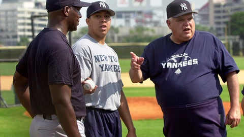 FILE - In this April 23, 2003, file photo, New York Yankees pitching development coach Billy Connors, right, talks to pitcher Jose Contreras, left, through interpreter Lou Astacio, center, at the Yankees' minor league facility in Tampa, Fla. Contreras pitched part of a simulated game.  Connors, a three-time Yankees pitching coach and confidant of late owner George Steinbrenner, has died. He was 76. The Yankees said Wednesday, June 20, 2018, that Connors died Monday. The team held a moment of silence before their game Wednesday night against the Seattle Mariners at Yankee Stadium. (AP Photo/Scott Martin, File)