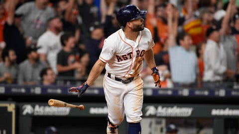 Houston Astros' Jose Altuve watches his solo home run off Tampa Bay Rays starting pitcher Nathan Eovaldi during the sixth inning of a baseball game Wednesday, June 20, 2018, in Houston. (AP Photo/Eric Christian Smith)
