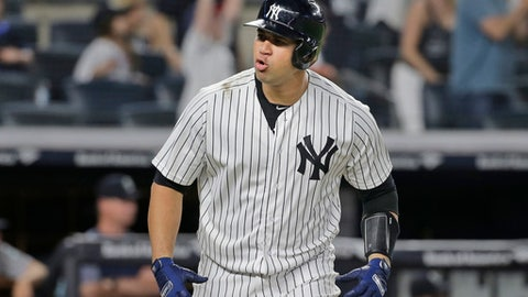 New York Yankees' Gary Sanchez reacts after hitting a two-run home run during the eighth inning of a baseball game against the Seattle Mariners at Yankee Stadium Wednesday, June 20, 2018, in New York. (AP Photo/Seth Wenig)