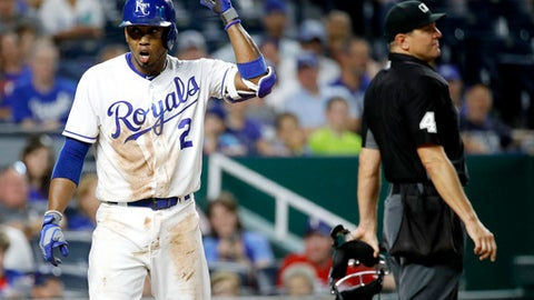 Kansas City Royals' Alcides Escobar reacts after being ejected from the game by home plate umpire Chad Fairchild during the eighth inning of a baseball game against the Texas Rangers Wednesday, June 20, 2018, in Kansas City, Mo. (AP Photo/Charlie Riedel)