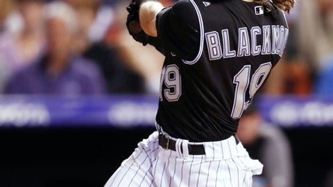 Colorado Rockies' Charlie Blackmon watches his solo home run off New York Mets relief pitcher Anthony Swarzak during the sixth inning of a baseball game Wednesday, June 20, 2018, in Denver. (AP Photo/David Zalubowski)