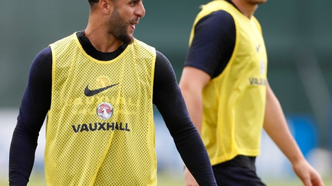 England's Kyle Walker smiles as he takes part in a training session for the England team at the 2018 soccer World Cup, in the Spartak Zelenogorsk ground, Zelenogorsk near St. Petersburg, Russia, Thursday, June 21, 2018. (AP Photo/Alastair Grant)