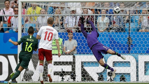 Denmark's Christian Eriksen, second left, scores the opening goal during the group C match between Denmark and Australia at the 2018 soccer World Cup in the Samara Arena in Samara, Russia, Thursday, June 21, 2018. (AP Photo/Gregorio Borgia)