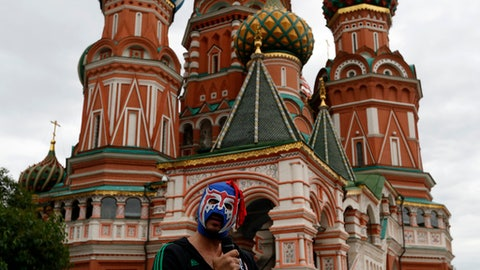 A supporter from Mexico addresses fellows supporters in front of the Saint Basil's Cathedral on the Red Square during the 2018 soccer World Cup in Moscow, Russia, Thursday, June 21, 2018. (AP Photo/Darko Bandic)