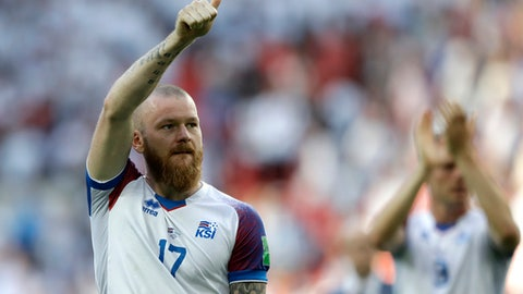 FILE - In this June 16, 2018 file photo, Iceland captain Aron Gunnarsson acknowledges spectators after a 1-1 draw in Group D between Argentina and Iceland at the World Cup at Spartak Stadium in Moscow, (AP Photo/Matthias Schrader, File)