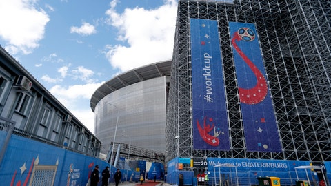 Stands that will be dismantled after World Cup games are seen on the right side of the Yekaterinburg Arena in Yekaterinburg, Russia, Thursday, June 21, 2018. The World Cup stadium in Yekaterinburg has two stands that are built outside the main structure. They sit atop towers of uncovered scaffolding. The stands are temporary and will be dismantled after the stadium's four World Cup games in the Ural Mountains city. (AP Photo/Natacha Pisarenko)