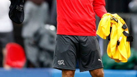 Switzerland head coach Vladimir Petkovic gestures as he arrives for the official training session of the Swiss team one the eve of the group E match between Switzerland and Serbia at the 2018 soccer World Cup at Kaliningrad stadium in Kaliningrad, Russia, Thursday, June 21, 2018. (AP Photo/Antonio Calanni)