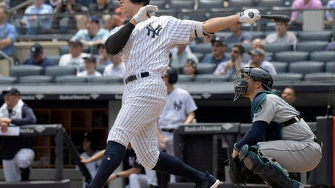New York Yankees' Aaron Judge hits a two-run home run as Seattle Mariners catcher Mike Zunino, right, looks on during the first inning of a baseball game Thursday, June 21, 2018, at Yankee Stadium in New York. (AP Photo/Bill Kostroun)