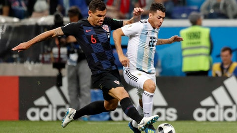 Croatia's Dejan Lovren, left, and Argentina's Cristian Pavon fight for the ball during the group D match between Argentina and Croatia at the 2018 soccer World Cup in Nizhny Novgorod Stadium in Novgorod, Russia, Thursday, June 21, 2018. (AP Photo/Pavel Golovkin)