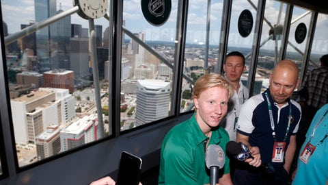 NHL Draft prospect Rasmus Dahlin, of Sweden, talks to the media in Dallas, Thursday, June 21, 2018. The NHL Draft takes place Friday and Saturday in Dallas. (AP Photo/Michael Ainsworth)
