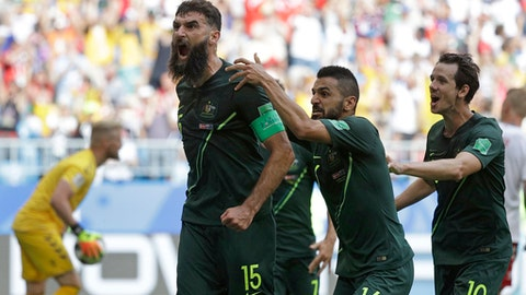 Australia's Mile Jedinak celebrates scoring his side's opening goal during the group C match between Denmark and Australia at the 2018 soccer World Cup in the Samara Arena in Samara, Russia, Thursday, June 21, 2018. (AP Photo/Gregorio Borgia)
