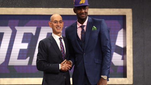 NEW YORK, NY - JUNE 21: Deandre Ayton poses with NBA Commissioner Adam Silver after being drafted first overall by the Phoenix Suns during the 2018 NBA Draft at the Barclays Center on June 21, 2018 in the Brooklyn borough of New York City. (Photo by Mike Stobe/Getty Images)