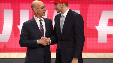 NEW YORK, NY - JUNE 21:  Luka Doncic poses with NBA Commissioner Adam Silver after being drafted third overall by the Atlanta Hawks during the 2018 NBA Draft at the Barclays Center on June 21, 2018 in the Brooklyn borough of New York City. (Photo by Mike Stobe/Getty Images)
