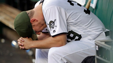 Pittsburgh Pirates starting pitcher Chad Kuhl sits in the dugout after being removed from the baseball game after giving up a two-run home run to Arizona Diamondbacks' Alex Avila during the third inning in Pittsburgh, Thursday, June 21, 2018. (AP Photo/Gene J. Puskar)