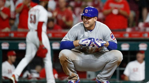 Chicago Cubs' Anthony Rizzo reacts after striking out to Cincinnati Reds relief pitcher Amir Garrett, left, during the seventh inning of a baseball game Thursday, June 21, 2018, in Cincinnati. (AP Photo/John Minchillo)