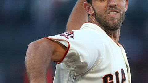 San Francisco Giants pitcher Madison Bumgarner works against the San Diego Padres during the first inning of a baseball game Thursday, June 21, 2018, in San Francisco. (AP Photo/Ben Margot)