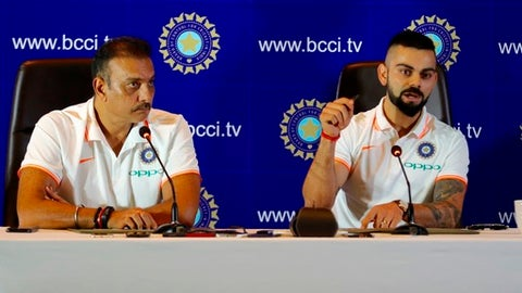 Indian cricket captain Virat Kohli, right and head coach Ravi Shastri address the media ahead of the teams travel to England and Ireland in New Delhi, India, Friday, June 22, 2018. (Manish Swarup)