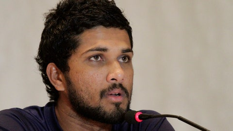 "FILE - In this Thursday, Nov. 9, 2017 file photo, Sri Lanka's Dinesh Chandimal attends a press conference prior to their cricket series against India in Kolkata, India. Sri Lanka's captain, coach, and manager have admitted to breaching the ""spirit of cricket"" by refusing to play the West Indies for two hours during the second test in St. Lucia. Captain Dinesh Chandimal, coach Chandika Hathurusinghe and manager Asanka Gurusinha admitted to the charge laid by International Cricket Council chief executive David Richardson following the test. (AP Photo/Bikas Das, File)"