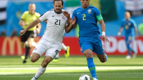 Brazil's Thiago Silva, right, challenges for the ball with Costa Rica's Marcos Urena, during the group E match between Brazil and Costa Rica at the 2018 soccer World Cup in the St. Petersburg Stadium in St. Petersburg, Russia, Friday, June 22, 2018. (AP Photo/Petr David Josek)