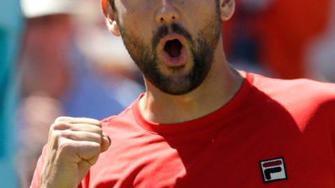 Marin Cilic of Croatia celebrates winning his quarterfinal tennis match against Sam Querrey of the USA during their at the Queen's Club tennis tournament in London, Friday, June 22, 2018. (AP Photo/Kirsty Wigglesworth)