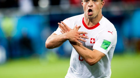 Switzerland's Xherdan Shaqiri celebrates after scoring his side's second goal during the group E match between Switzerland and Serbia at the 2018 soccer World Cup in the Kaliningrad Stadium in Kaliningrad, Russia, Friday, June 22, 2018. (Laurent Gillieron/Keystone via AP)