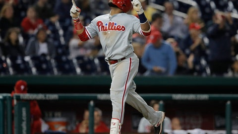 Philadelphia Phillies' Carlos Santana celebrates his two-run home run after rounding third base on his way home in the sixth inning of a baseball game against the Washington Nationals at Nationals Park, Friday, June 22, 2018, in Washington. (AP Photo/Carolyn Kaster)