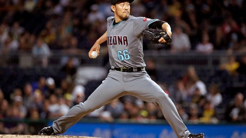 Arizona Diamondbacks relief pitcher Yoshihisa Hirano delivers in the eighth inning of the team's baseball game against the Pittsburgh Pirates in Pittsburgh, Friday, June 22, 2018. (AP Photo/Gene J. Puskar)