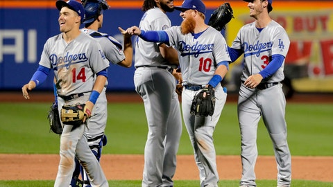 The Los Angeles Dodgers celebrate after defeating the New York Mets in a baseball game, Friday, June 22, 2018, in New York. (AP Photo/Julie Jacobson)
