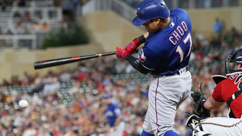 Texas Rangers' Shin-Soo Choo, of South Korea, hits an RBI single off Minnesota Twins pitcher Matt Belisle during the ninth inning of a baseball game Friday, June 22, 2018, in Minneapolis. The Rangers won 8-1. Choo had three RBIs in the game. (AP Photo/Jim Mone)