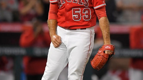 Los Angeles Angels relief pitcher Blake Parker celebrates after the Angels defeated the Toronto Blue Jays 2-1 in a baseball game against the Toronto Blue Jays on Friday, June 22, 2018, in Anaheim, Calif. (AP Photo/Mark J. Terrill)