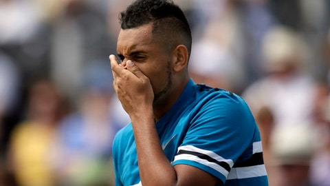 Australia's Nick Kyrgios reacts during his semifinal tennis match against Croatia's Marin Cilic at the Queen's Club tennis tournament in London, Saturday, June 23, 2018. (AP Photo/Tim Ireland)