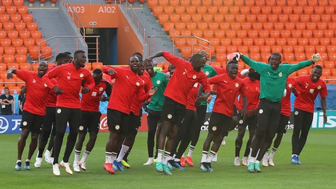 Senegal players dance during the official training on the eve of the group H match between Japan and Senegal at the 2018 soccer World Cup in the Yekaterinburg Arena in Yekaterinburg, Russia, Saturday, June 23, 2018. (AP Photo/Eugene Hoshiko)