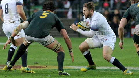 England's Elliot Daly, right, faces South Africa's Franco Mostert, left, during the third rugby test match between South Africa and England at Newlands in Cape Town, South Africa, Saturday, June 23, 2018. (AP Photo/Nasief Manie)